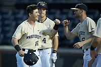 Chris Lanzilli (24) of the Wake Forest Demon Deacons bumps fists with teammate Jake Mueller (6) after hitting a 2-run home run against the Liberty Flames at David F. Couch Ballpark on April 25, 2018 in  Winston-Salem, North Carolina.  The Demon Deacons defeated the Flames 8-7.  (Brian Westerholt/Four Seam Images)