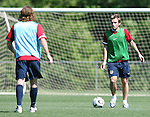 12 May 2006: Bobby Convey (r) is watched by John O'Brien (l) during a scrimmage. The United States' Men's National Team trained at SAS Soccer Park in Cary, NC, in preparation for the 2006 FIFA World Cup tournament to be played in Germany from June 9 through July 9, 2006.