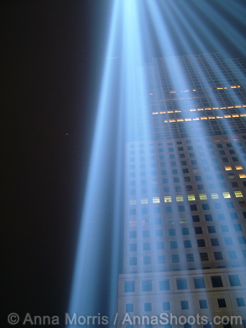 Remembering 9/11 with Beams of Light from Ground Zero. Seen from the platform, the beams appear to merge into a single point of light in the sky. From a distance, they appear to be twin towers of light reaching up to the heavens.