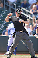 Home plate umpire Brian Hertzog throws a new ball back to the pitcher during the game between the Las Vegas 51s and the Omaha Storm Chasers at Werner Park on August 17, 2014 in Omaha, Nebraska. The Storm Chasers  won 4-0.   (Dennis Hubbard/Four Seam Images)