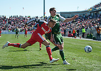 26 March 2011: Portland Timbers forward Kenny Cooper #33 and Toronto FC defender Adrian Cann #12 in action during an MLS game between the Portland Timbers and the Toronto FC at BMO Field in Toronto, Ontario Canada..Toronto FC won 2-0....