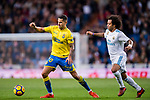 Victor Machin Perez of UD Las Palmas (L) fights for the ball with Marcelo Vieira Da Silva of Real Madrid (R) during the La Liga 2017-18 match between Real Madrid and UD Las Palmas at Estadio Santiago Bernabeu on November 05 2017 in Madrid, Spain. Photo by Diego Gonzalez / Power Sport Images