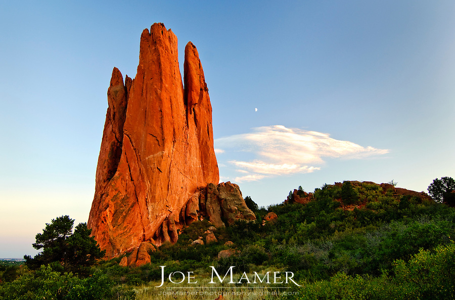 Moonrise at the Tower of Babel rock formation at The Garden of the Gods in Colorado Springs, Colorado. The Garden of the Gods was originally a gift to the citizens of Colorado Springs by the family of local landowner Charles Elliott Perkins in 1909, who stipulated that access should remain forever free..
