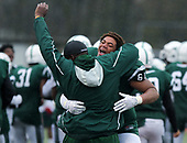 Jamar Ross (61) and defensive line coach Justin Ibe, West Bloomfield, celebrate after defeating Detroit Case Tech 9-7 in Division 1 semifinal football action at Troy Athens High School Saturday, Nov. 18, 2017. (For The Oakland Press / LARRY McKEE)