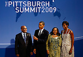 Pittsburgh, PA - September 24, 2009 -- United States President Barack Obama (2L) and U.S. first lady Michelle Obama (R) welcome South African President Jacob Zuma (L) and his wife Nompumelelo Ntuli to the opening dinner for G-20 leaders at the Phipps Conservatory on September 24, 2009 in Pittsburgh, Pennsylvania. Heads of state from the world's leading economic powers arrived today for the two-day G-20 summit held at the David L. Lawrence Convention Center aimed at promoting economic growth.  .Credit: Win McNamee / Pool via CNP