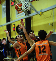Action from the 2017 A Boys' Secondary Schools Basketball Premiership National Championship match between Manukura College (black and red) and Nga Taiatea Wharekura (orange) at the B&M Centre in Palmerston North, New Zealand on Monday, 2 October 2017. Photo: Dave Lintott / lintottphoto.co.nz