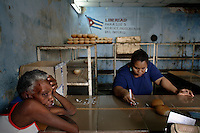 People buy bread in a bakery in Havana, Cuba on 4 August 2006.<br />