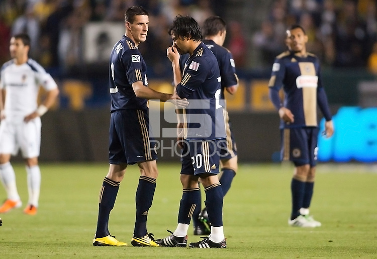 Philadelphia Union forward Sebastien Le Toux (L-9) chats with team mate Carlos Ruiz (R-20). The LA Galaxy defeated the Philadelphia Union 1-0 at Home Depot Center stadium in Carson, California on  April  2, 2011....