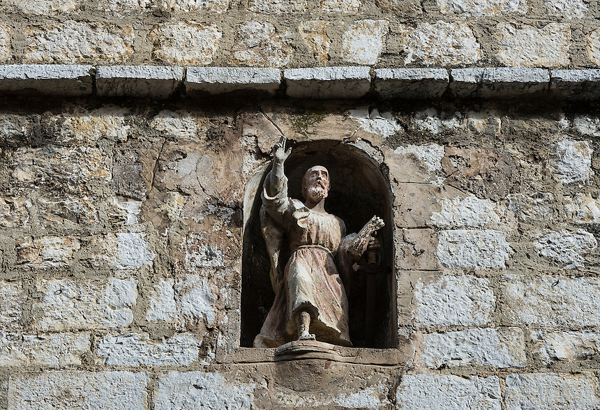 Church wall crevice with sculptue figure of the apostle St Paul, St Paul de Vance, Provence, France