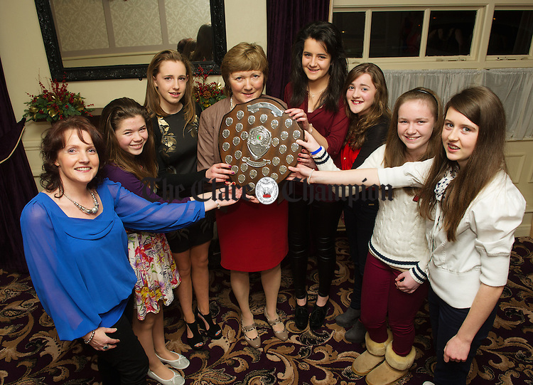 Inagh-Kilnamona's Veronica Cotter, mentor,  Sinead Powell, Claire Hehir, Margaret Lafferty, Club chairperson, Michelle Flanagan, Orla Cotter, Roisin Clancy and Chloe Mc Namara at the Clare Camogie Board Club Awards Night in the Auburn Lodge Hotel, Ennis. Photograph by John Kelly.
