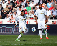 Pictured: Jonathan de Guzman takes a free kick which goes over the Manchester City cross bar. Saturday 04 May 2013<br />