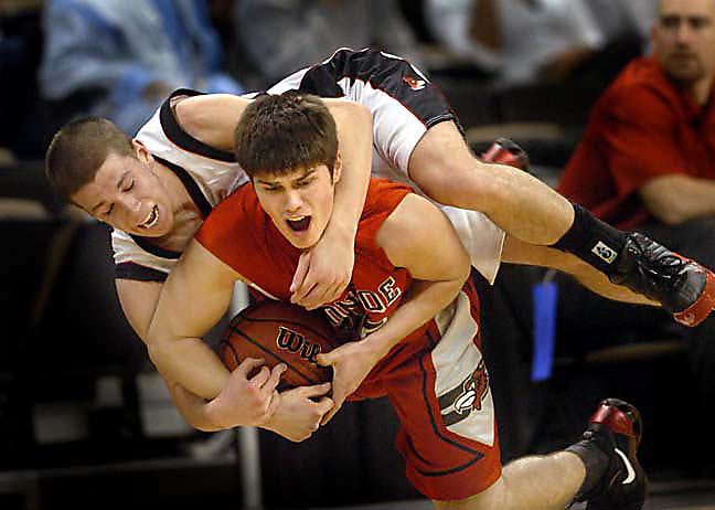 "Pisgah High School's Tony Blake (12,top) fights for the ball with Monroe's Preston Hagler (35) during Pisgah's 68-62 West Regional win at Joel Coliseum. 04mbjtr01.jpg  ""scramble"""