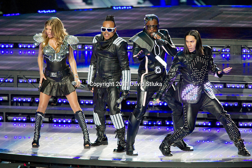 Recording artists Black Eyed Peas from left to right, Fergie, apl.de.ap, will.i.am, and Taboo perform during halftime of the Pittsburgh Steelers Super Bowl XLV football game against the Green Bay Packers on Sunday, February 6, 2011, in Arlington, Texas. The Packers won 31-25. (AP Photo/David Stluka)