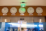 Clocks showing major international cities current times line the entrance of the Delta Sky Club in the Maynard H. Jackson Jr. International Terminal at Hartsfield–Jackson Atlanta International Airport, in Atlanta, Georgia on August 28, 2013.