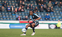 Marcus Bean of Wycombe Wanderers plays a pass during the Sky Bet League 2 match between Wycombe Wanderers and Stevenage at Adams Park, High Wycombe, England on 12 March 2016. Photo by Andy Rowland/PRiME Media Images.