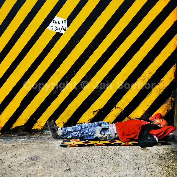 A Colombian homeless man sleeps on the street in the center of Bogotá, Colombia, 24 November 2017.