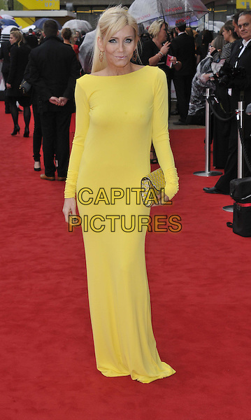 Michelle Collins.Arqiva British Academy Television Awards in 2013 at the Royal Festival Hall, London, England..12th May 2013.BAFTA BAFTAS full length yellow dress clutch bag .CAP/DS.©Dudley Smith/Capital Pictures