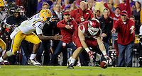 11/14/15<br /> Arkansas Democrat-Gazette/STEPHEN B. THORNTON<br /> Arkansas' Brooks Ellis (51), RIGHT, pickS up a fumble by LSU's QB Brandon Harris, left,  during the second quarter of their game Saturday in Baton Rouge, La.