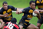 Ioane Ioane has Jeremy Biggelaar in support as he tries to evade the tackle of Tony Tiakia. Counties Manukau Premier Club Rugby game between Papakura & Bombay played at Massey Park Papakura on Saturday May 30th 2009..Bombay won 57 - 7 after leading 24 - 0 at halftime.