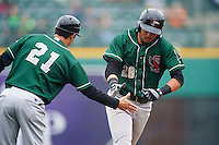 Great Lakes Loons third baseman Edwin Rios (28) shakes hands with coach Gil Velazquez (21) after hitting a home run during the first game of a doubleheader against the Fort Wayne TinCaps on May 11, 2016 at Parkview Field in Fort Wayne, Indiana.  Great Lakes defeated Fort Wayne 3-0.  (Mike Janes/Four Seam Images)