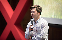 """Donovan Dennis '16 talks about """"When Caring Isn't Enough: The Climate Crisis and You.""""<br /> Occidental College's second TEDx event, Choi Auditorium, April 2, 2016. Featuring talks on sustainability and global development by speakers that included five students, a faculty member and seven external speakers.<br /> (Photo by Marc Campos, Occidental College Photographer)"""