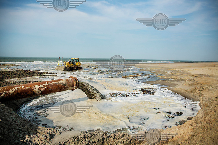A pipline pumps sand from a sand bank in the sea as part of the Belgian Coast Safety Plan. The Governement launched this plan in order to protect the coastline against the threat of a super storm which could cause a major flood. This beach in Oostende will be covered with 500,000 m³ of sand in order to elevate it by one to three meters.