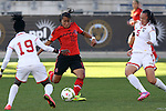 26 October 2014: Sandra Stephany Mayor (MEX) (10) scores a goal past Arin King (TRI) (5). The Trinidad & Tobago Women's National Team played the Mexico Women's National Team at PPL Park in Chester, Pennsylvania in the 2014 CONCACAF Women's Championship Third Place game. Mexico won the game 4-2 after extra time. With the win, Mexico qualified for next year's Women's World Cup in Canada and Trinidad & Tobago face playoff for spot against Ecuador.