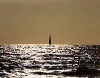 A lone sailor on a sterling sea