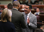 Nevada Gov. Brian Sandoval greets Sen. Aaron Ford, D-Las Vegas, before U.S. Senate Majority Leader Harry Reid's address at the Legislature, in Carson City, Nev., on Wednesday, Feb. 20, 2013. .Photo by Cathleen Allison