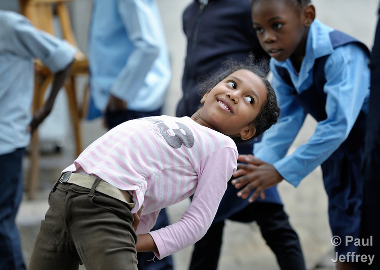 A refugee girl stretches during physical education class in a school operated by St. Andrew's Refugee Services in Cairo, Egypt. Located at St. Andrews United Church of Cairo, the program is supported by Church World Service.