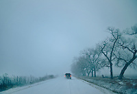 Driving through morning mist and snow during a hunting trip near Grand Island, Nebraska, Saturday, December 3, 2011. Hunting duck and White Tail deer is common in the area...Photo by Matt Nager
