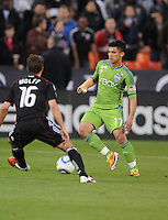 Seattle Sounders midfielder Freddy Montero (17)  goes against DC United forward Josh Wolff (16)  DC United defeated The Seattle Sounders 2-1 at  RFK Stadium, Wednesday May 4, 2011.