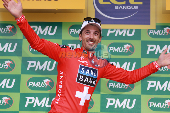 Fabian Cancellara about to get the green jersey after winning the first stage prologue in the 2009 Tour de France, 4th July 2009 (Photo by Manus OReilly/NEWSFILE)