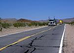 Trucks on a freeway crossing the Mojave Desert, California, USA