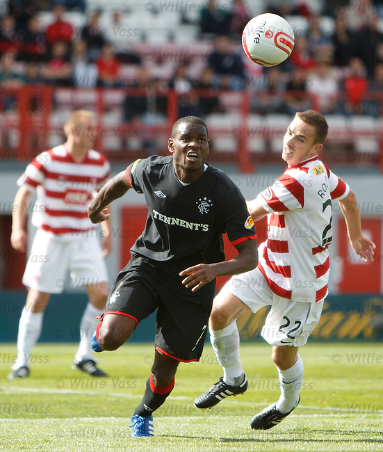 Maurice Edu chases down the ball in the box