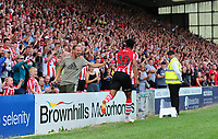 Lincoln City's Matt Green celebrates scoring his sides fourth goal with the fans<br /> <br /> Photographer Chris Vaughan/CameraSport<br /> <br /> The EFL Sky Bet League Two - Lincoln City v Swindon Town - Saturday 11th August 2018 - Sincil Bank - Lincoln<br /> <br /> World Copyright &copy; 2018 CameraSport. All rights reserved. 43 Linden Ave. Countesthorpe. Leicester. England. LE8 5PG - Tel: +44 (0) 116 277 4147 - admin@camerasport.com - www.camerasport.com