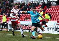 Lewis Coyle of Fleetwood Town wins the ball from Ashley Hunter of Fleetwood Town during the Sky Bet League 1 match between Doncaster Rovers and Fleetwood Town at the Keepmoat Stadium, Doncaster, England on 17 February 2018. Photo by Leila Coker / PRiME Media Images.