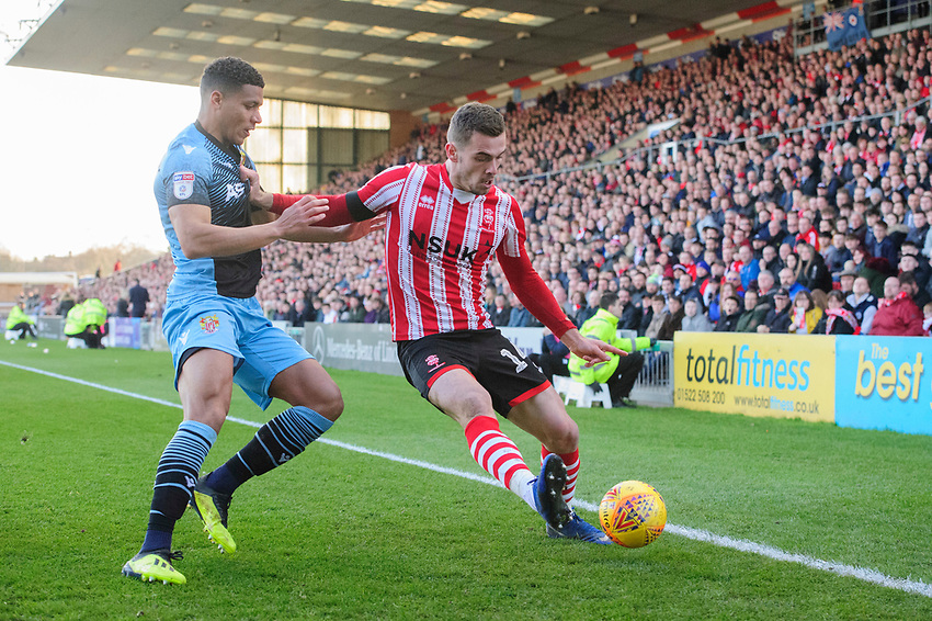 Lincoln City's Harry Toffolo shields the ball from Stevenage's Luther Wildin<br /> <br /> Photographer Chris Vaughan/CameraSport<br /> <br /> The EFL Sky Bet League Two - Lincoln City v Stevenage - Saturday 16th February 2019 - Sincil Bank - Lincoln<br /> <br /> World Copyright © 2019 CameraSport. All rights reserved. 43 Linden Ave. Countesthorpe. Leicester. England. LE8 5PG - Tel: +44 (0) 116 277 4147 - admin@camerasport.com - www.camerasport.com