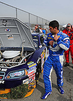 Feb 21, 2009; Fontana, CA, USA; NASCAR Sprint Cup Series driver Reed Sorenson surveys the damage to his car after crashing during practice for the Auto Club 500 at Auto Club Speedway. Mandatory Credit: Mark J. Rebilas-
