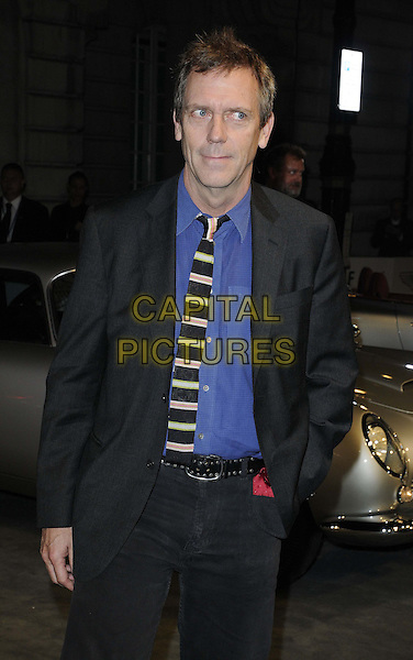 Hugh Laurie.The 'Skyfall' Aston Martin VIP screening, Curzon Mayfair cinema, Curzon St., London, England..October 24th, 2012.half length black suit tie jacket tie stripe blue shirt jeans denim hand in pocket .CAP/CAN.©Can Nguyen/Capital Pictures.