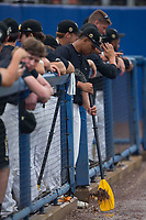 Christian Long (19) of the Wake Forest Demon Deacons uses an oar to move some water away from the dugout aftr a lengthy rain delay in Game Three of the Gainesville Super Regional of the 2017 College World Series against the Florida Gators at Alfred McKethan Stadium at Perry Field on June 12, 2017 in Gainesville, Florida.  The Gators defeated the Demon Deacons 3-0 to advance to the College World Series in Omaha, Nebraska.   (Brian Westerholt/Four Seam Images)