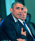 United States President Barack Obama meets with his Cabinet in the Cabinet Room of the White House in Washington, D.C. on Friday, November 7, 2014. Secretary of Defense Chuck Hagel is at right.<br /> Credit: Dennis Brack / Pool via CNP