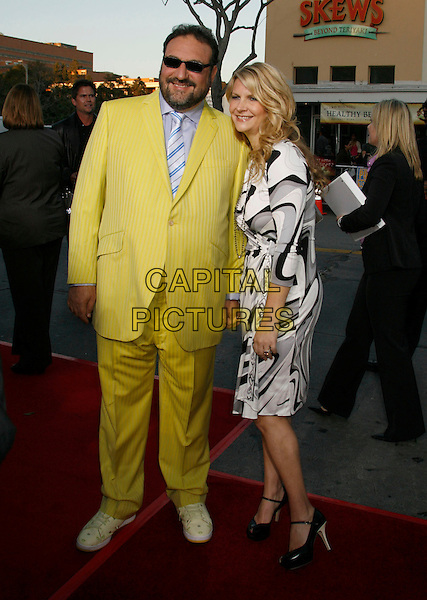 "JOEL SILVER & KARYN FIELDS.""The Reaping"" Los Angeles Premiere held at Mann's Village Theatre, Hollywood, California, USA..March 29th, 2007.full length suit white black dress pattern Karen beard facial hair yellow married husband wife.CAP/ADM/RE.©Russ Elliot/AdMedia/Capital Pictures"