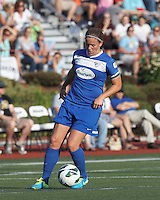 Boston Breakers defender Cat Whitehill (4) controls the ball. In a National Women's Soccer League (NWSL) match, Boston Breakers (blue) tied Western New York Flash (white), 2-2, at Dilboy Stadium on August 3, 2013.