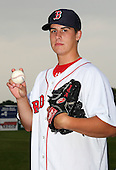 Lowell Spinners pitcher Keith Couch (25) poses for a photo in a Boston Red Sox uniform during a rain delay at Falcon Park in Auburn, New York August 9, 2010.  Couch was selected in the 2010 MLB Draft by the Red Sox in the 13th round (413th overall) out of Adelphi University.  The game between the Lowell Spinners and Auburn Doubledays was cancelled due to rain.  Photo By Mike Janes/Four Seam Images