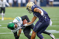 Annapolis, MD - October 26, 2019: Navy Midshipmen linebacker Jacob Springer (1) tackles Tulane Green Wave quarterback Justin McMillan (12) during the game between Tulane and Navy at  Navy-Marine Corps Memorial Stadium in Annapolis, MD.   (Photo by Elliott Brown/Media Images International)