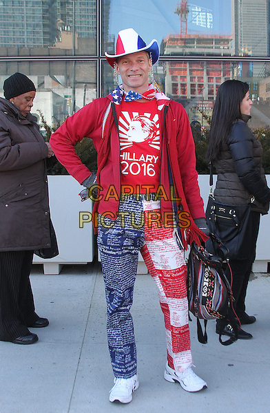 NEW YORK, NY - MARCH 2:  U.S presidential candiate Hillary Clinton supporter sporting a colorful red, white and blue outfit waits on line outside Hillary Clinton rally at the Jacob Davits Center in New York, New York on March 2, 2016.  <br /> CAP/MPI/RMP<br /> &copy;RMP/MPI/Capital Pictures