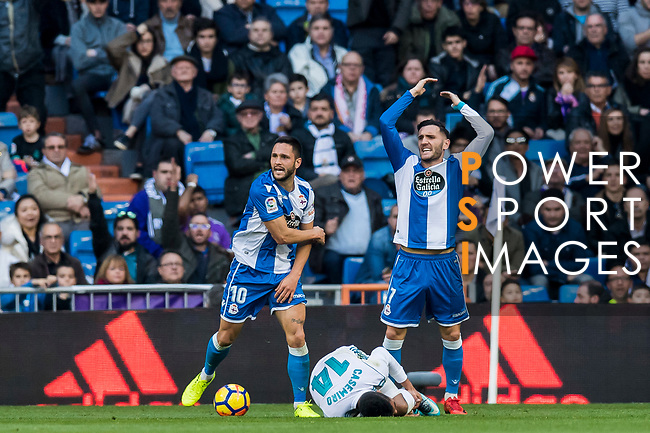Florin Andone and Lucas Perez Martinez of RC Deportivo La Coruna reacts as Carlos Henrique Casemiro of Real Madrid lies on the pitch during the La Liga 2017-18 match between Real Madrid and RC Deportivo La Coruna at Santiago Bernabeu Stadium on January 21 2018 in Madrid, Spain. Photo by Diego Gonzalez / Power Sport Images
