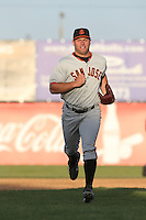 Tyler Horan (39) of the San Jose Giants returns to the dugout during a game against the Lancaster JetHawks at The Hanger on April 11, 2015 in Lancaster, California. San Jose defeated Lancaster, 8-3. (Larry Goren/Four Seam Images)