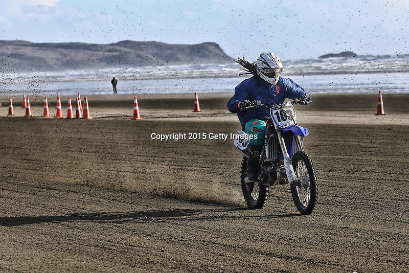 INVERCARGILL, NEW ZEALAND - NOVEMBER 27:  Sam Riwhi of Invercargill races in  the Indian Motorcycle NZ Beach Racing Champs during the 10th Anniversary of the 2015 Burt Munro Challenge at Oreti Beach on November 27, 2015 in Invercargill, New Zealand.  (Photo by Dianne Manson/Getty Images) *** Local Caption ***